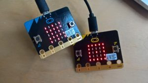 picture of Micro:bit circuit board with LEDs flashing