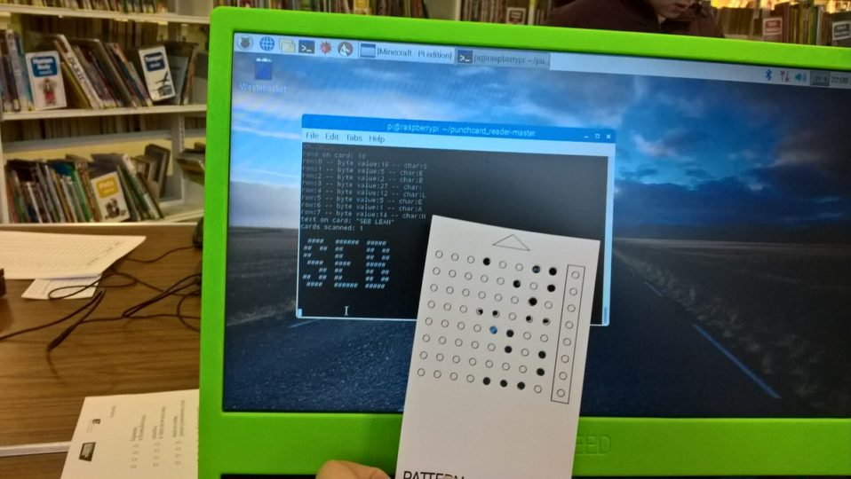 screen with code and binary punched